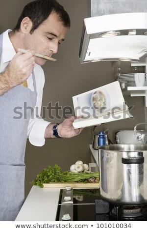 ストックフォト: 男 · 読む · レシピ · 図書 · キッチン · 家族