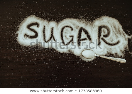 The word 'Diabetes' handwritten with white chalk on a blackboard stock photo © nenovbrothers