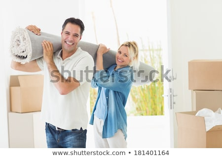 Couple carrying packed rug Stock photo © photography33
