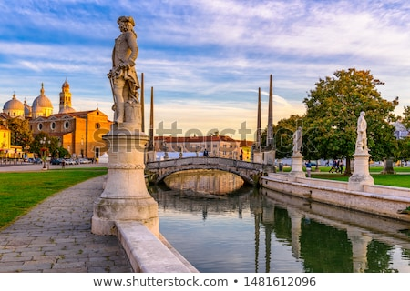 Water canal with reflections in Padova stock photo © mariematata