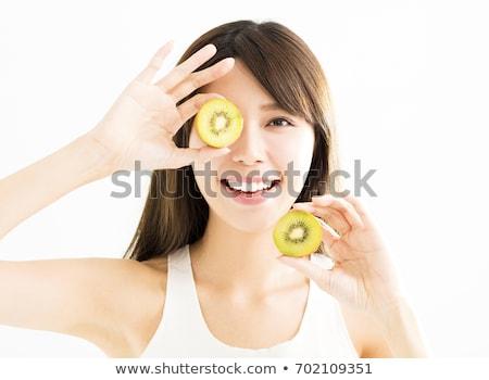 Genç kadın kivi kadın gıda gülümseme Stok fotoğraf © pedromonteiro