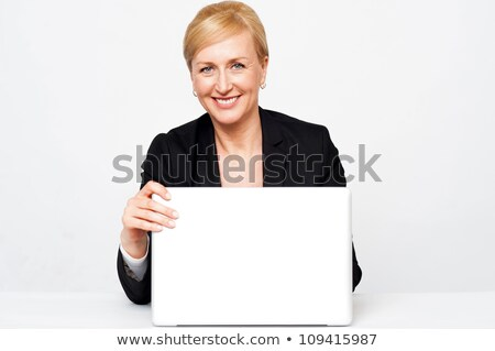 Secretary holding laptop flap, about to close Stock photo © stockyimages