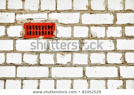 Brick wall with primitive ventilation Stock photo © pzaxe