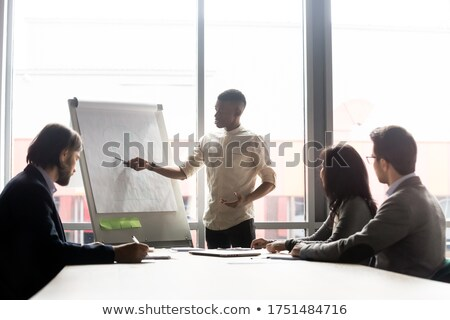 cool young company ceo communicating stock photo © stockyimages