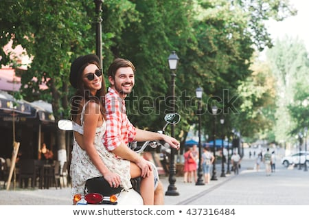 Girl riding on her boyfriend's shoulder stock photo © stockyimages