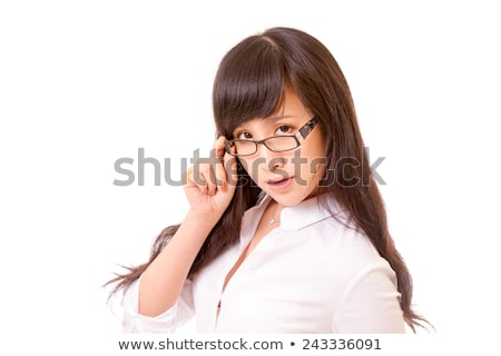 businesswoman peering over her glasses stock photo © stryjek