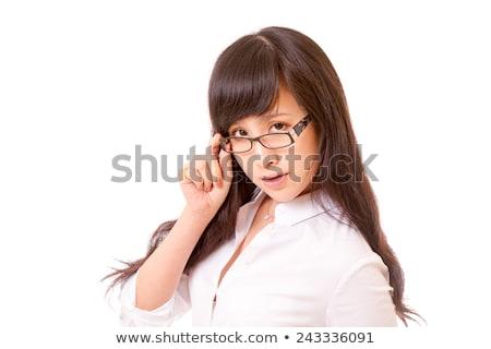Businesswoman peering over her glasses stock photo © stryjek