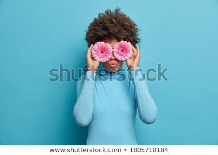 blue eyes and blue daisy Stock photo © carlodapino