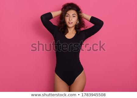 Appassionato giovani bruna nero leggings isolato Foto d'archivio © acidgrey