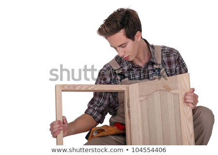 young cabinetmaker making cupboard Stock photo © photography33