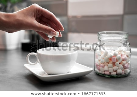 woman with marshmallows on fingers stock photo © photography33
