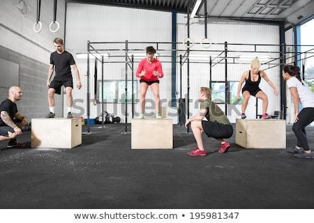 crossfit box jump people group and kettlebell man stock photo © lunamarina