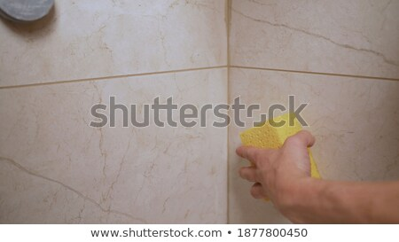 man holding tiles on yellow background stock photo © photography33