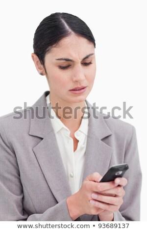 Közelkép üzletasszony zavart szöveges üzenet fehér technológia Stock fotó © wavebreak_media