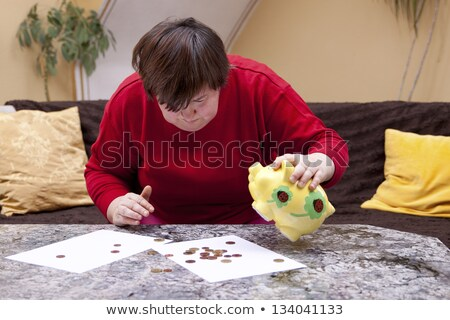 Disabled woman looking desperately for little money stock photo © Pasiphae