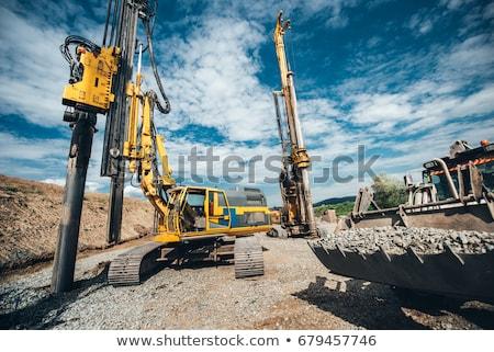 Excavator and drill machine. Stock photo © ABBPhoto
