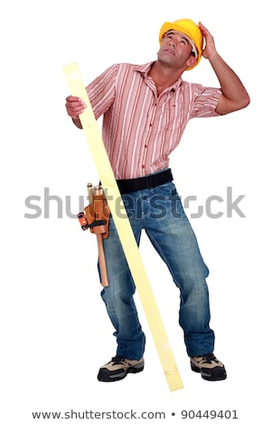 Tradesman trying to protect himself from falling debris Stock photo © photography33