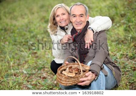 Férfi néz gombák erdő portré mosolyog Stock fotó © photography33