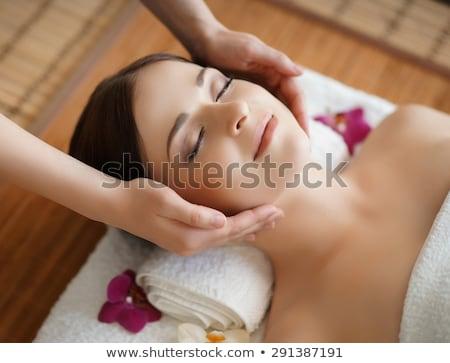 Mooie vrouw gezicht massage witte handdoek rond Stockfoto © lunamarina