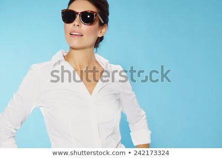 Güzel bir kadın beyaz bluz yalıtılmış beyaz gülümseme kadın Stok fotoğraf © RuslanOmega