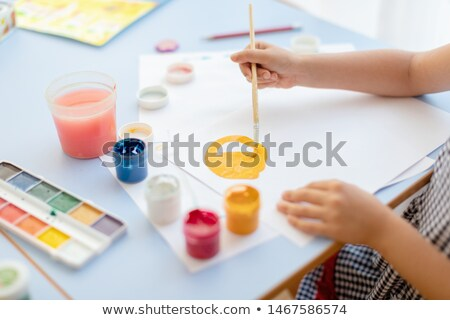 Art palette, tubes with paints and paintbrushes  Stock photo © tannjuska