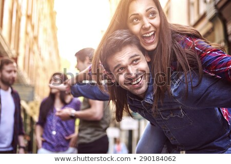 casual couple with man holding arms wide open Stock photo © feedough