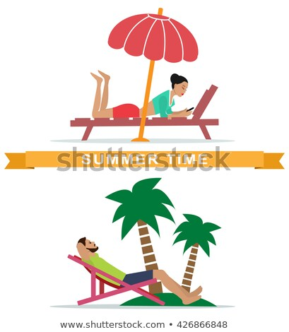 of a set of chairs sun beds and umbrellas for the beach stock photo © yurkina