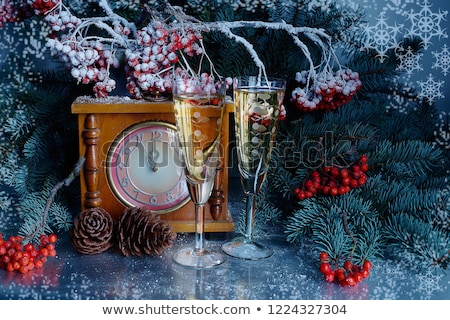 christmas balls and vintage clock with glass of champagne stock photo © stevanovicigor