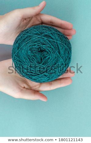 Closeup of woman knitting with teal wool Stock photo © sarahdoow
