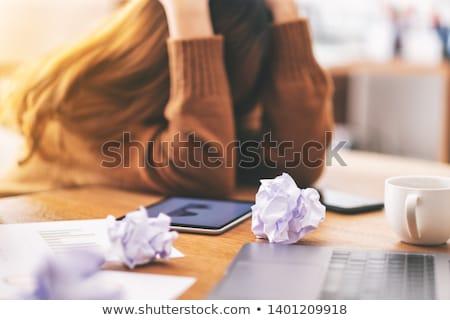 Woman crumpling paper in frustration Stock photo © AndreyPopov