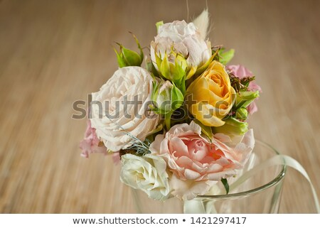 Small bouquet of roses on table at wedding stock photo © avdveen