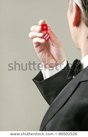 Gentleman Preparing To Roll Dice Stock photo © jackethead