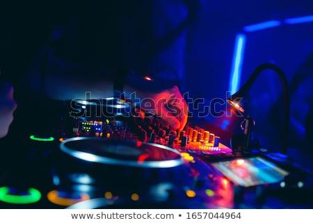 disc jockey and audience stock photo © derocz