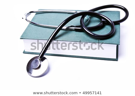 stethoscope on red book isolated on white background Stock photo © natika
