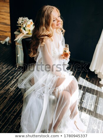 Beautiful woman with a glass of champagne Stock photo © Nejron