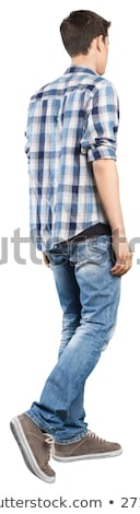 Back view of going handsome man in jeans and a shirt Stock photo © ashumskiy