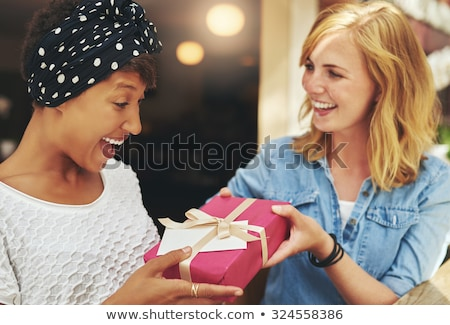 Vivacious laughing young blond woman Stock photo © dash