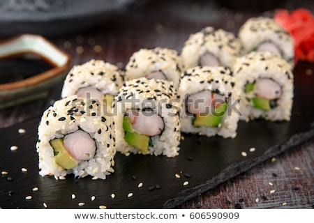 sushi rolls with sesame avocado and shrimp stock photo © olira