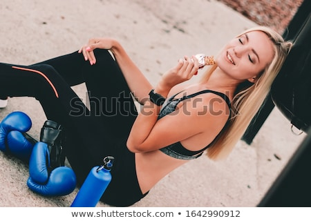Woman eating cereals Stock photo © trendsetterimages