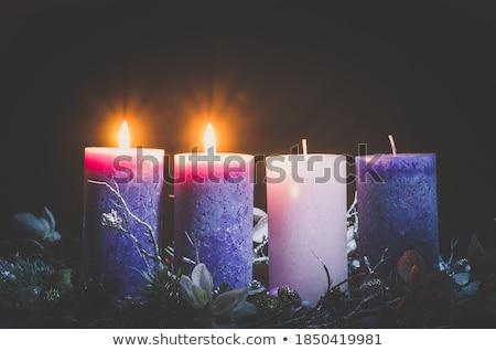 Four advent candles at black background Stock photo © olandsfokus