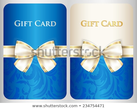 Blue vertical gift card with damask ornament and cream diagonal ribbon Stock photo © liliwhite