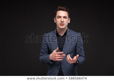 Fiatal divat férfi magyaráz valami tart Stock fotó © feedough