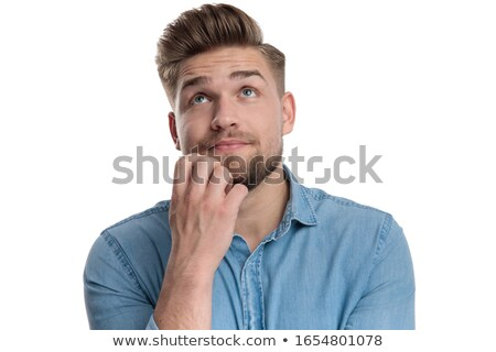 Young man wonders Stock photo © filipw