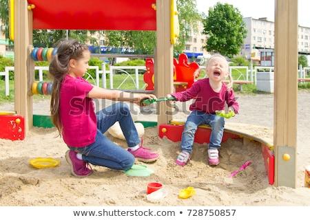 Child`s toy in sandbox Stock photo © dariazu