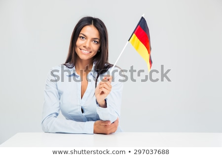 Patriotic woman holding germany flag Stock photo © deandrobot