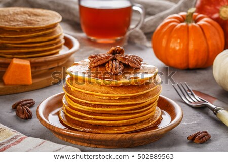 Pumpkin pancakes with pecans and syrup. Stock photo © rojoimages