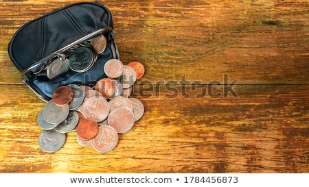 close up of dollar money in black wallet on table Stock photo © dolgachov