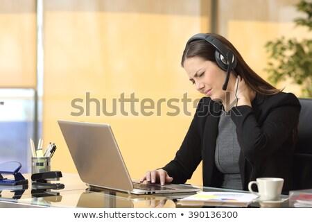 Zakenvrouw lijden nekpijn met behulp van laptop jonge grijs Stockfoto © AndreyPopov