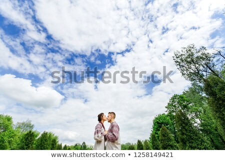 fiance and bride kiss against the background of the clouds stock photo © Paha_L
