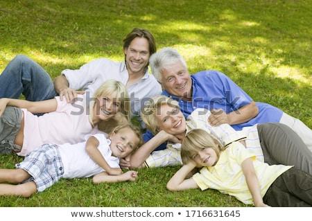 three men, laying on the grass stock photo © Paha_L